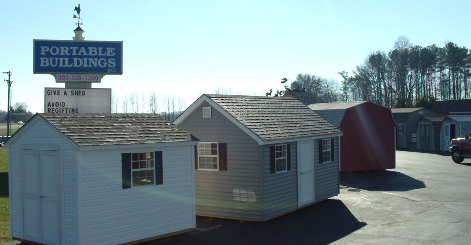 Portable Buildings Inc Factory in Milford, DE has a large inventory of sheds and wooden swing sets