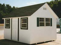 Custom built cape cod shed with Wrapped Windows